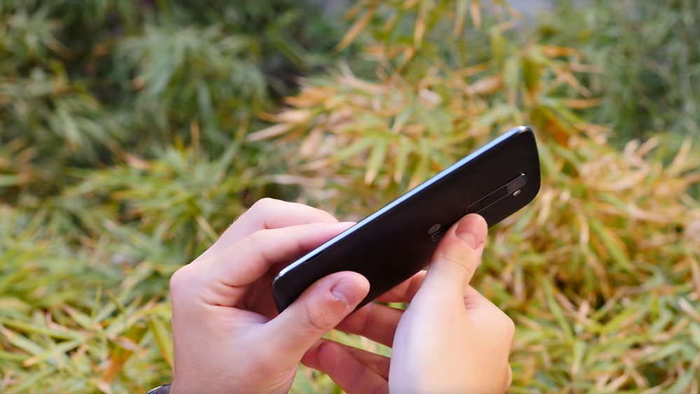 Hands tilting the LG K10 phone
