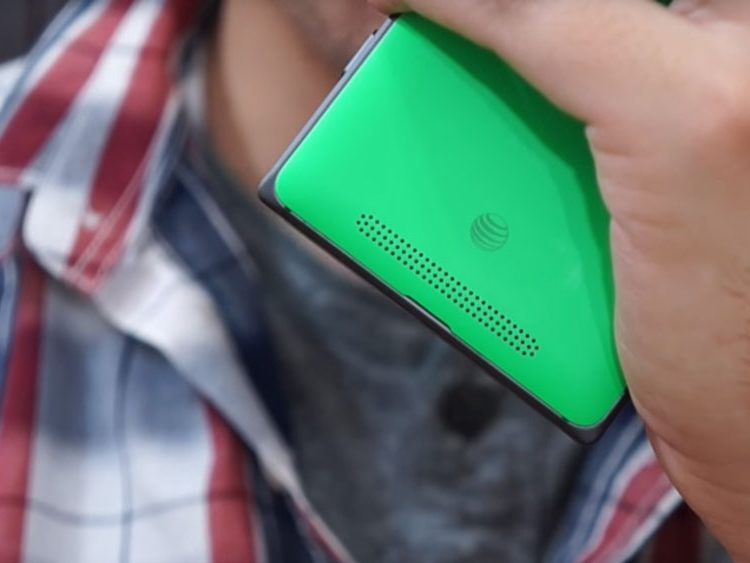 A Glimpse of the Nokia Lumia 830 while being used to hold a phone conversation