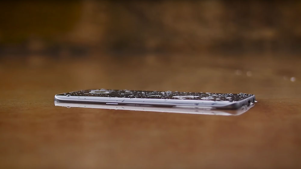 Samsung S7 Active lying on floor covered in water droplets
