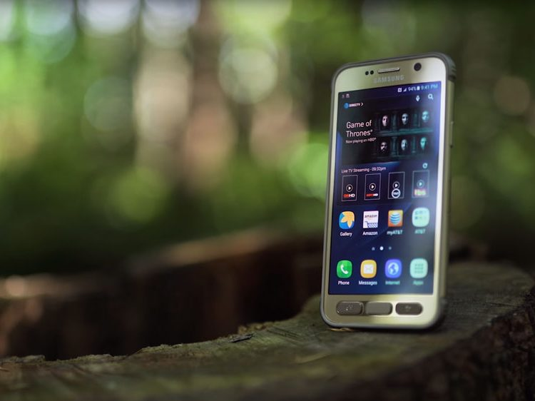 Samsung S7 Active standing upright on tree with bokeh behind