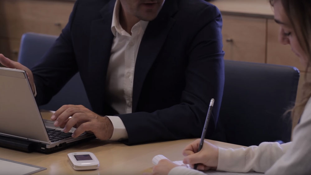 ZTE Velocity Hotspot being used for a business meeting between two people