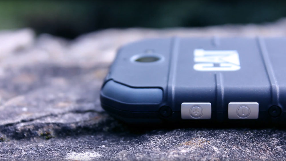 The side buttons of the Cat S30 while lying on a rock