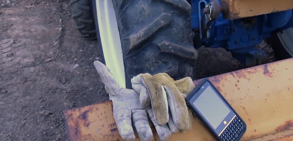 NEC Terrain on a truck shovel near work gloves