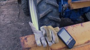 NEC Terrain on a truck shovel near work gloves