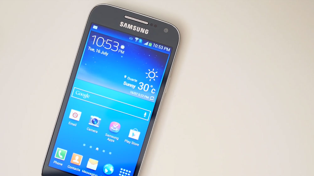 The Samsung Galaxy S4 Mini lying on a white background