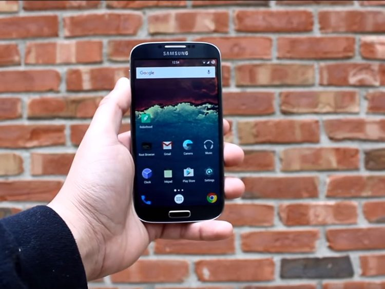 The Samsung Galaxy S4 Active held in front of a brick wall