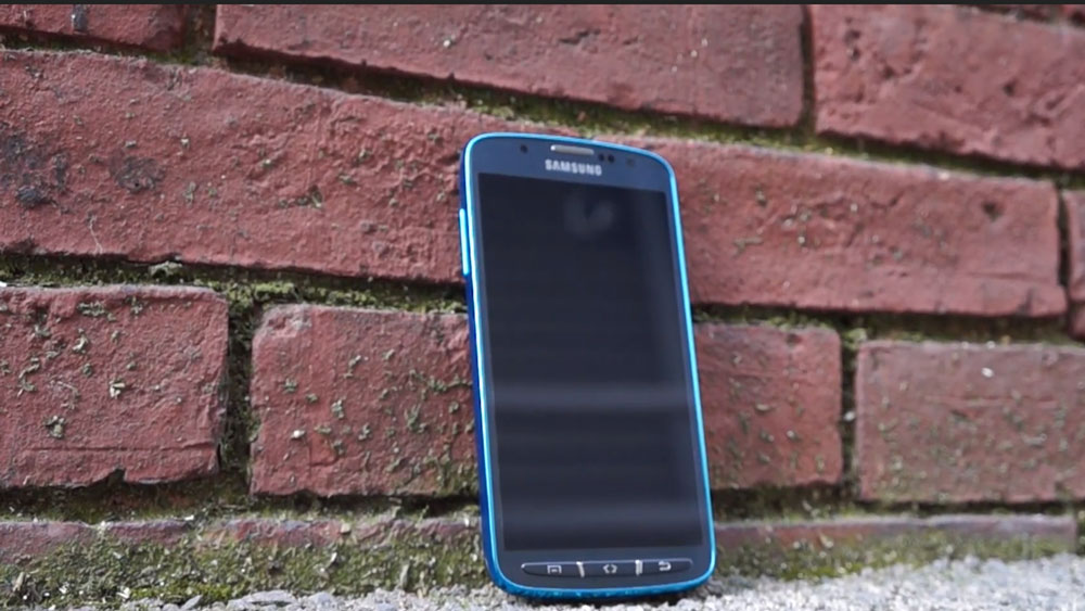 The Samsung Galaxy S4 Active leaning against a brick wall