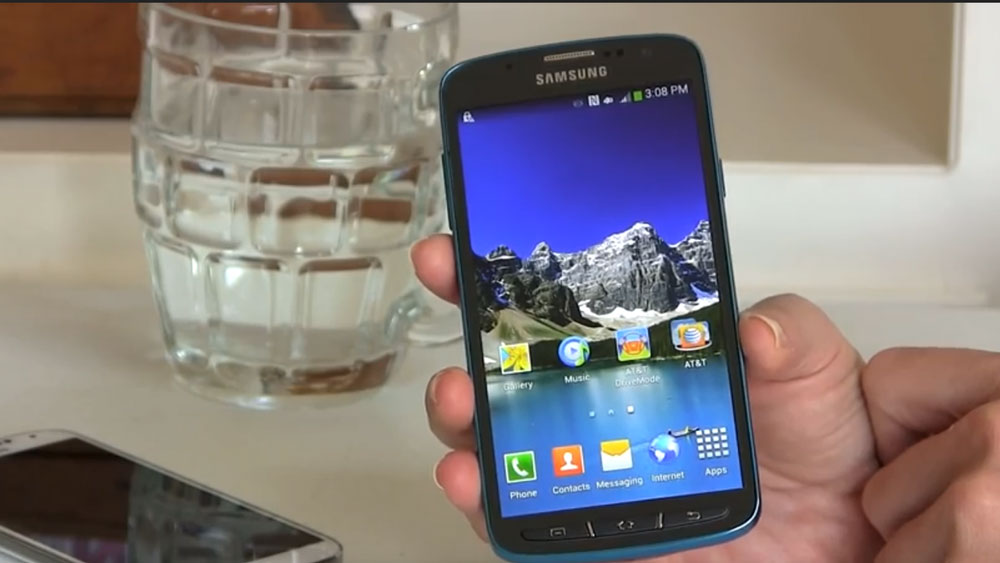Showing the front of the Samsung Galaxy S4 Active in front of a table