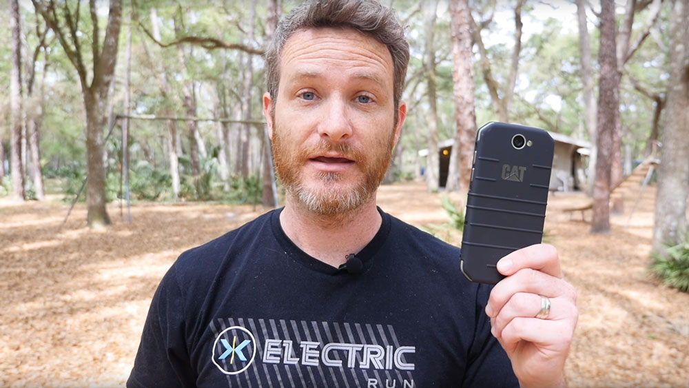 Man looking at camera holding the Cat S31