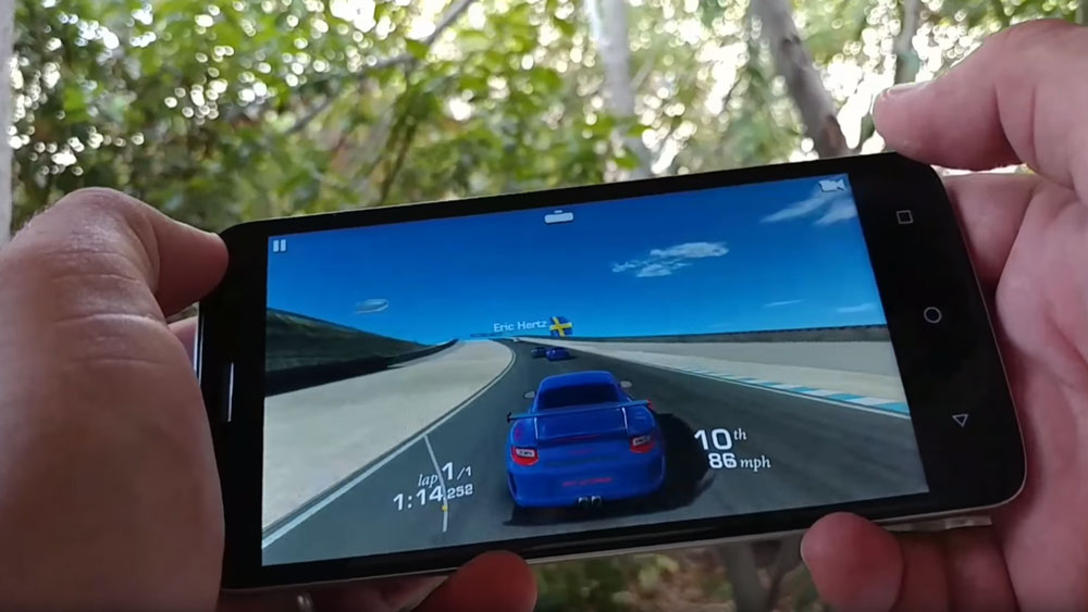 Someone using the ZTE Blade Spark to play a racing game