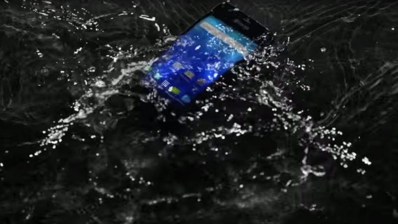 Kyocera Hydro Wave in a dark puddle