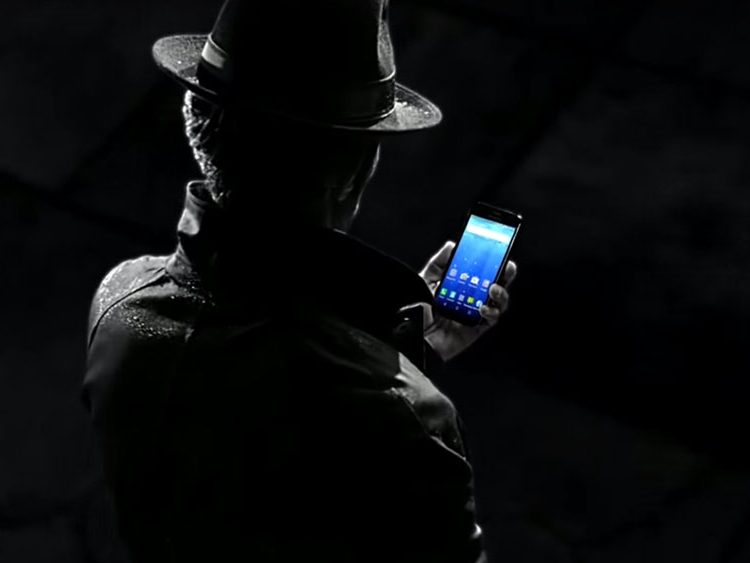Man in the shadows holding a Kyocera Hydro Wave