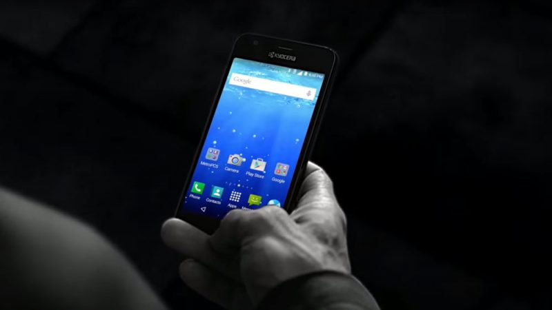 A Man's hand typing on the Kyocera Hydro Wave