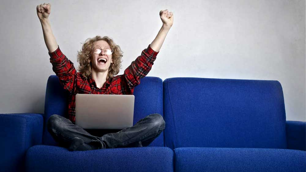 sitting happy person using laptop