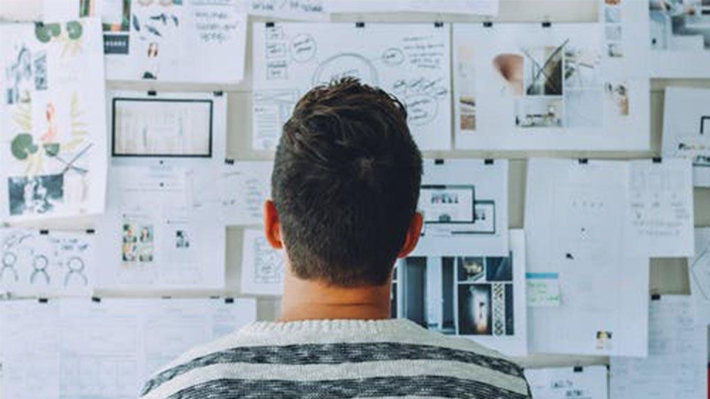 Man looking at planning board