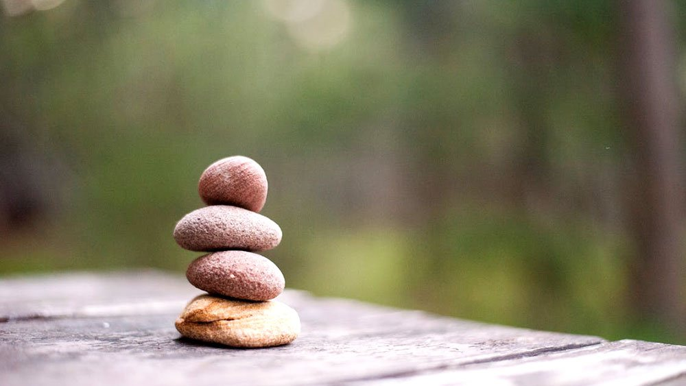 Rocks stacked on wooden table