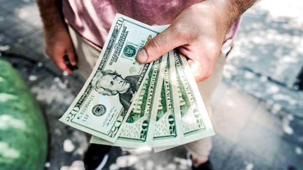 person hold four 20 dollar bills