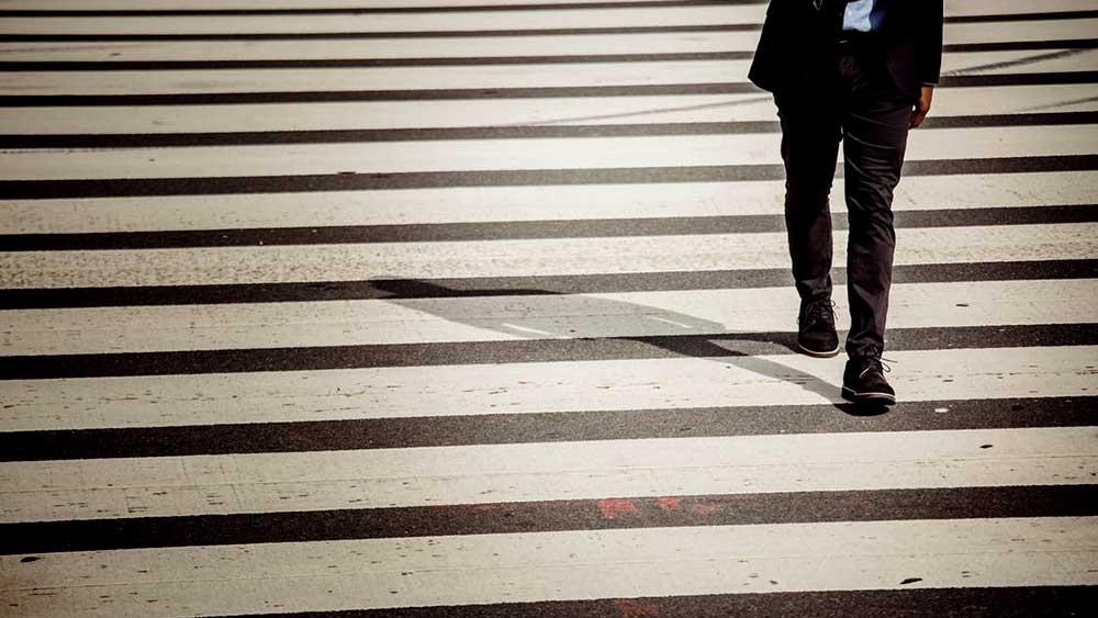 Man on crosswalk on phone