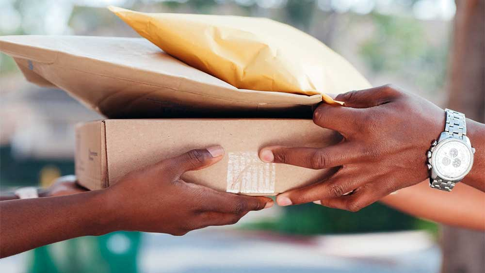 people exchanging packages