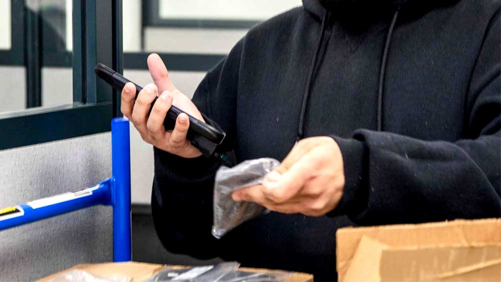 Person using RS60 Scanner