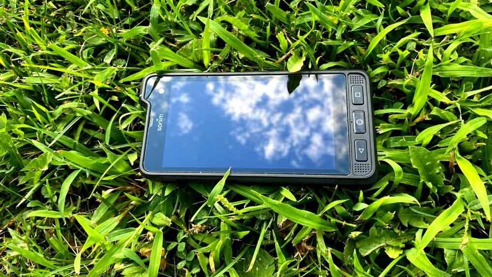 Sonim XP8 top view in grass