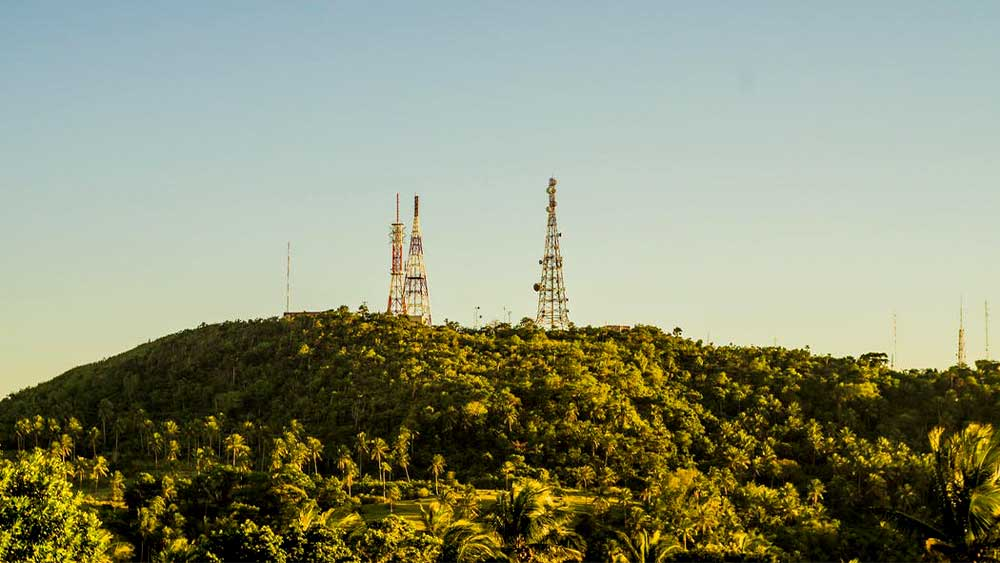 Cell towers on top green mountain